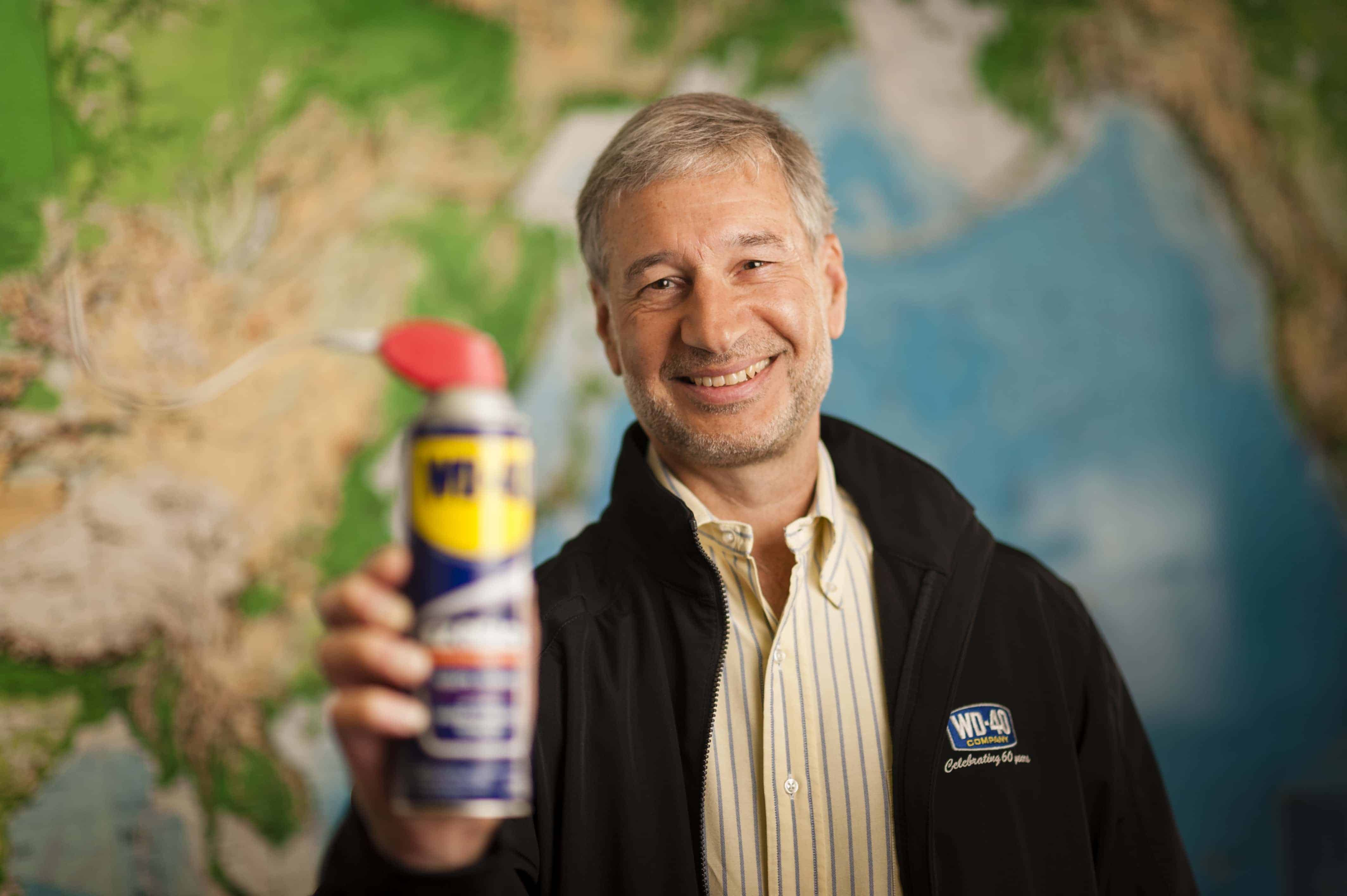 Rich holding WD-40 can